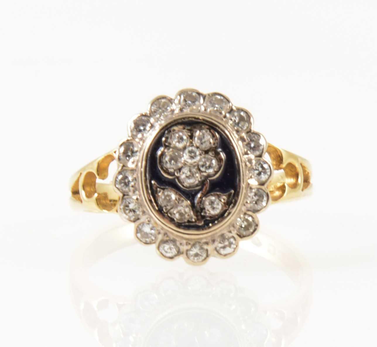 Lot 36-A diamond and enamel dress ring.