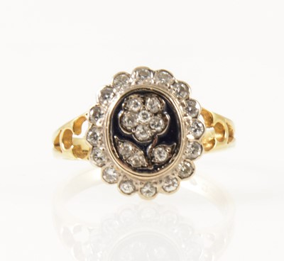 Lot 36-A diamond and enamel dress ring.