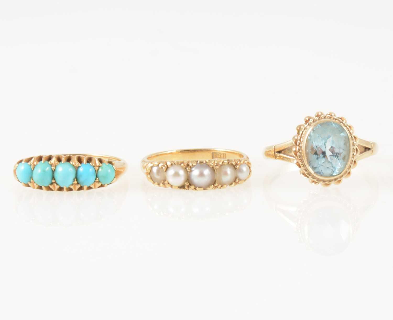 Lot 47-Three gemset dress rings.