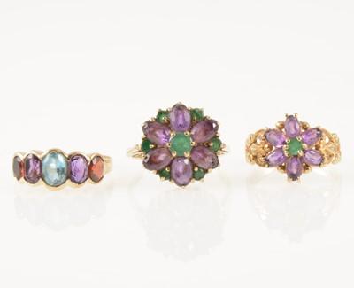 Lot 46-Three vintage amethyst dress rings.