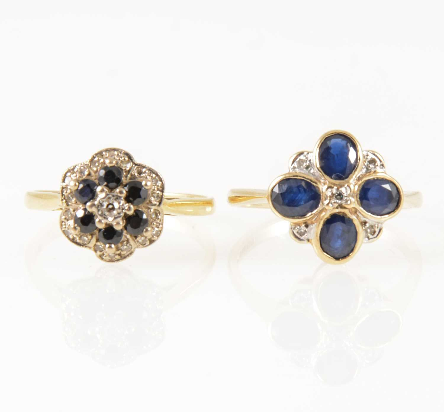 Lot 40-Two sapphire and diamond circular cluster rings.