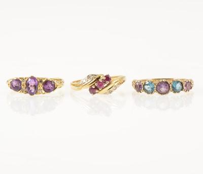 Lot 45-Three gemset dress rings.
