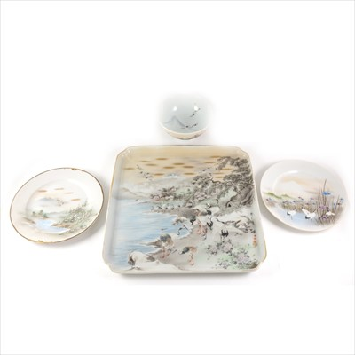 Lot 6-A large Japanese porcelain tray with Cranes before mount Fuji, and three other porcelain items.