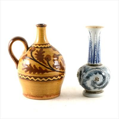 Lot 9-Doulton Lambeth stoneware vase designed by Frank Butler, 1873; and a slipware vase