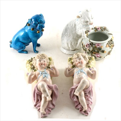 Lot 10-A pair of Continental porcelain wall pockets, modelled with cherubs; a modelled cat posy bowl...