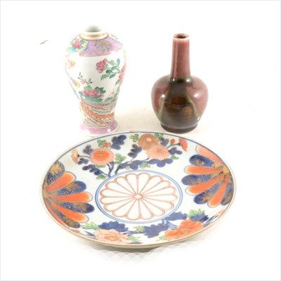 Lot 25-An Arita style porcelain plate, a Chinese famille rose vase, and a high fired vase