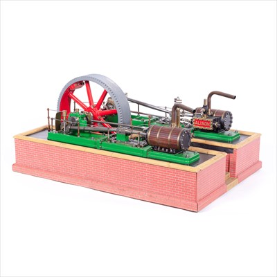 Lot 6-A well-built horizontal stationary engine, twin cylinder piston, 9inch flywheel, named 'Amy' and 'Alison'.