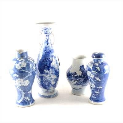 Lot 24-A Chinese blue and white vase, a similar vase with matching cover, an two Japanese vases
