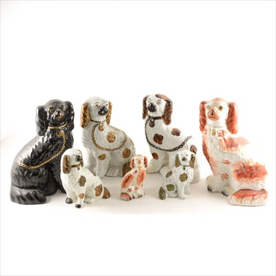Lot 39-A collection of twelve Staffordshire King Charles Spaniels