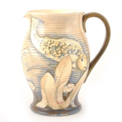 Lot 546-William Moorcroft, a 'Fish' salt glazed jug, circa 1930