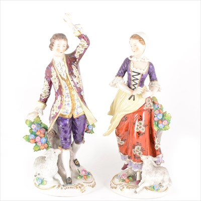 Lot 52-A pair of large Sitzendorf figures, lady and gentleman with sheep