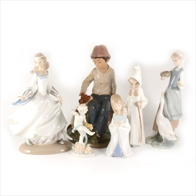 Lot 5-Four Lladro figures, one Nao figures, and a German figure.