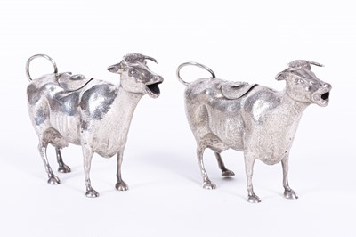 Lot 262-Two similar Victorian silver cow creamers, lacking maker's mark, London, one dated 1884