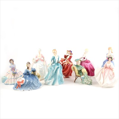 Lot 34-Eight Royal Doulton figurines, and a Coalport figurine