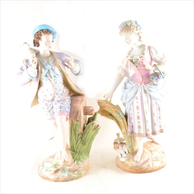 Lot 8-Pair of German porcelain figures of a shepherd boy and country girl (damaged), 43cm.