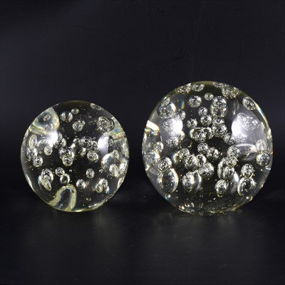 Lot 30-A large glass dumpy 'paperweight', and another similar