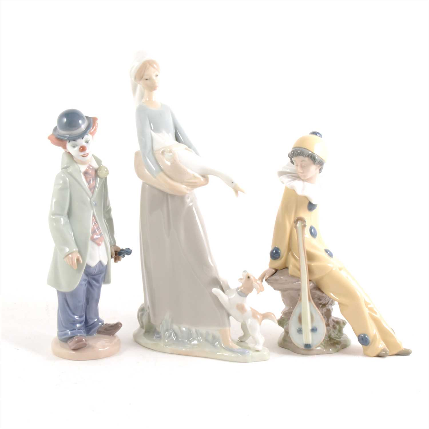 Lot 2-A Lladro figure of a clown and violin, and two Nao figures.