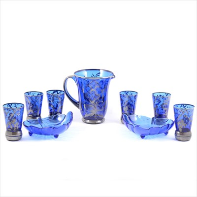 Lot 28-A 1920s blue glass lemonade jug and set of six tumblers, silvered overlay, two modern blue glass dishes.