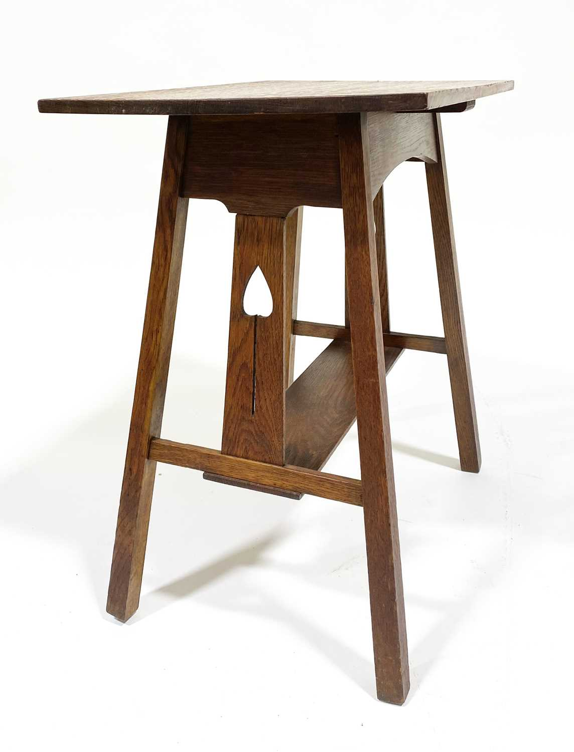 Lot 541-An Arts & Crafts oak side table, possibly by E A Taylor for Wylie & Lochhead