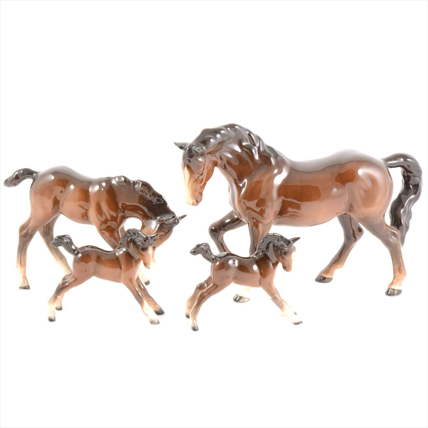 Lot 18-Four Beswick horses and foals