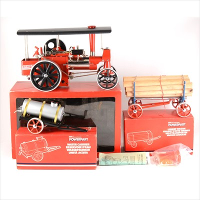 Lot 26-Wilesco Germany live steam Massey Ferguson traction engine, with Lumber wagon and Water Carrier, all boxed.