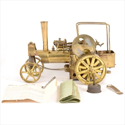 Lot 34-Wilesco live steam; D40 'Old Smokey' traction engine, in gold, with funnel and instructions (no canopy).