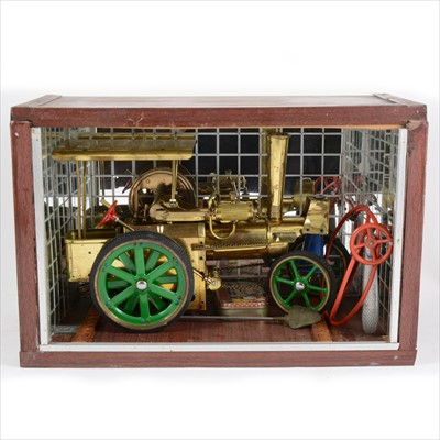 Lot 30-Wilesco live steam; D40 'Old Smokey' traction engine, in brass, with home-made display case and accessories. .