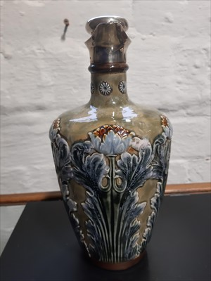 Lot 1-A pair of Doulton stoneware flasks with silver rim and stoppers with corks.
