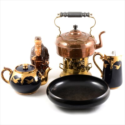 Lot 15-A copper kettle with brass burner, Doulton black dish, teapot, milk jug and monk decanter.
