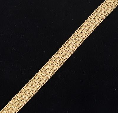 Lot 88-An 18 carat yellow gold bracelet.