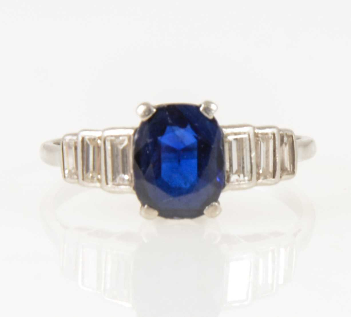 Lot 18-A sapphire and diamond ring.