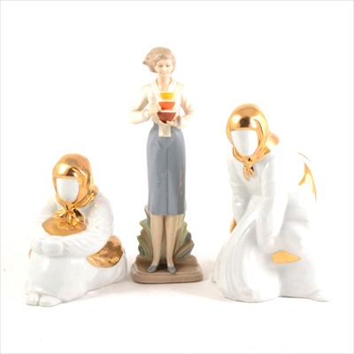 Lot 79-Three Spanish ceramic figures and publications relating to Lladro.