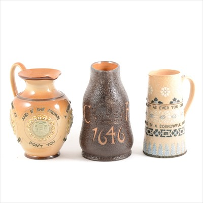 Lot 6-Three Doulton Lambeth stoneware jugs, including a Slater's Jack jug for King Charles' coronation 1646
