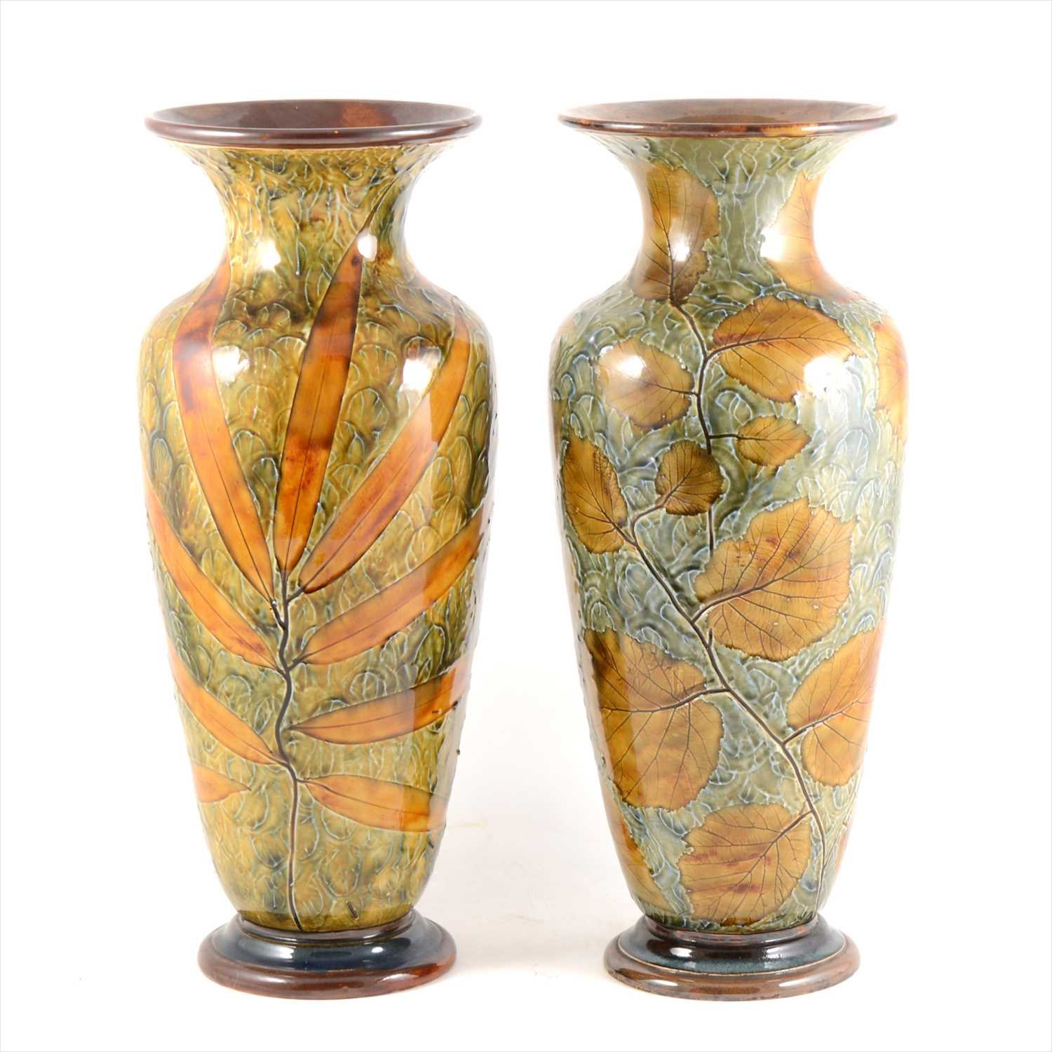 Lot 27-A large pair of Doulton Lambeth stoneware 'Autumn Leaves' vases