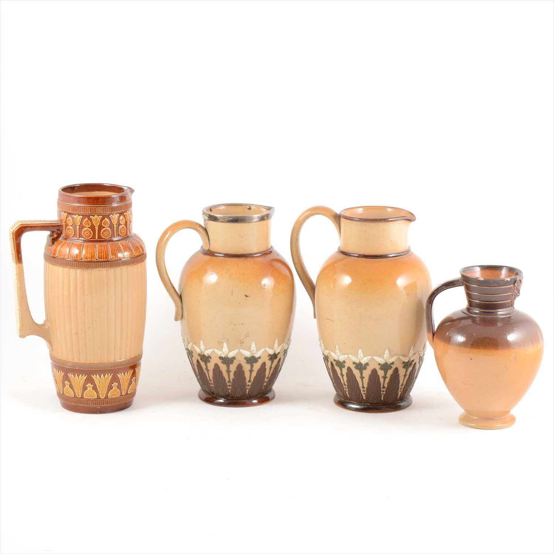 Lot 29-Four Doulton Lambeth stoneware jugs