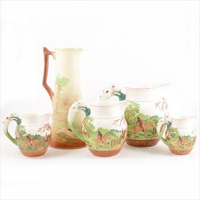 Lot 20-Set of four Wedgwood graduated jugs, Dye Ken John Peel hunting pattern