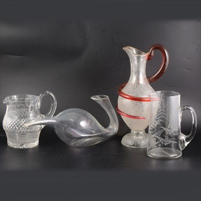 Lot 75-Frosted glass ewer with coiled serpent handle, collection of glass jugs, decanters etc.