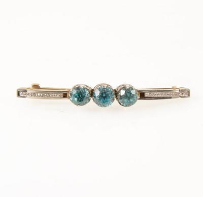 Lot 65-A heat treated blue zircon and diamond brooch.