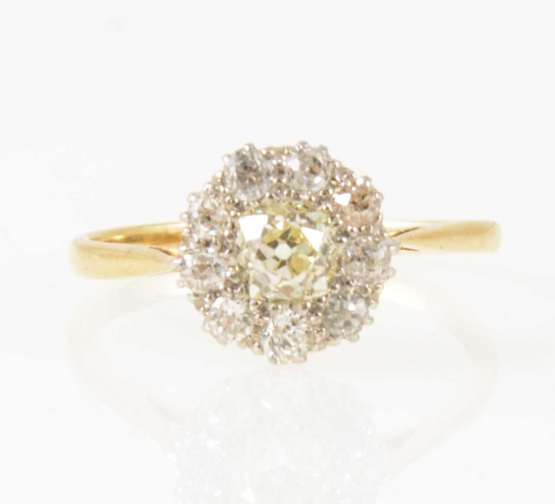 Lot 10-A diamond circular cluster ring.