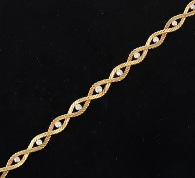 Lot 84-An 18 carat yellow gold bracelet set with eleven diamonds.