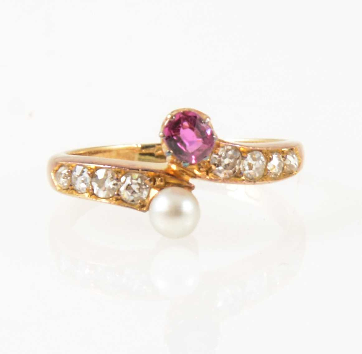Lot 29-A pearl and diamond crossover ring.