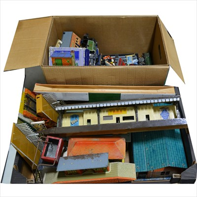 Lot 42-Two boxes of model railway accessories, parts, spares, tin-plate O gauge buildings, die-cast trains, track-side scenery and others.