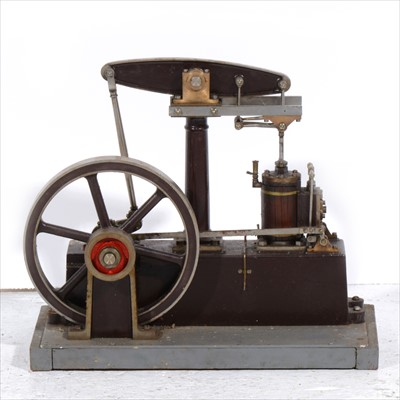 Lot 4-A Stuart Turner beam engine; live steam model with 7inch flywheel, mounted into wooden base, 32cm length.