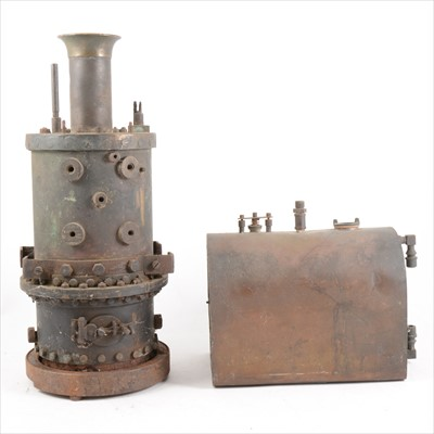 Lot 12-A cast metal vertical upright live steam boiler and another horizontal boiler part.