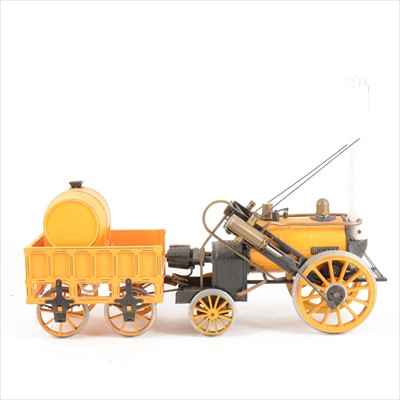 Lot 35-Hornby 3 1/2inch gauge live steam Stephenson Rocket locomotive with wagon, 42cm total length, unboxed.