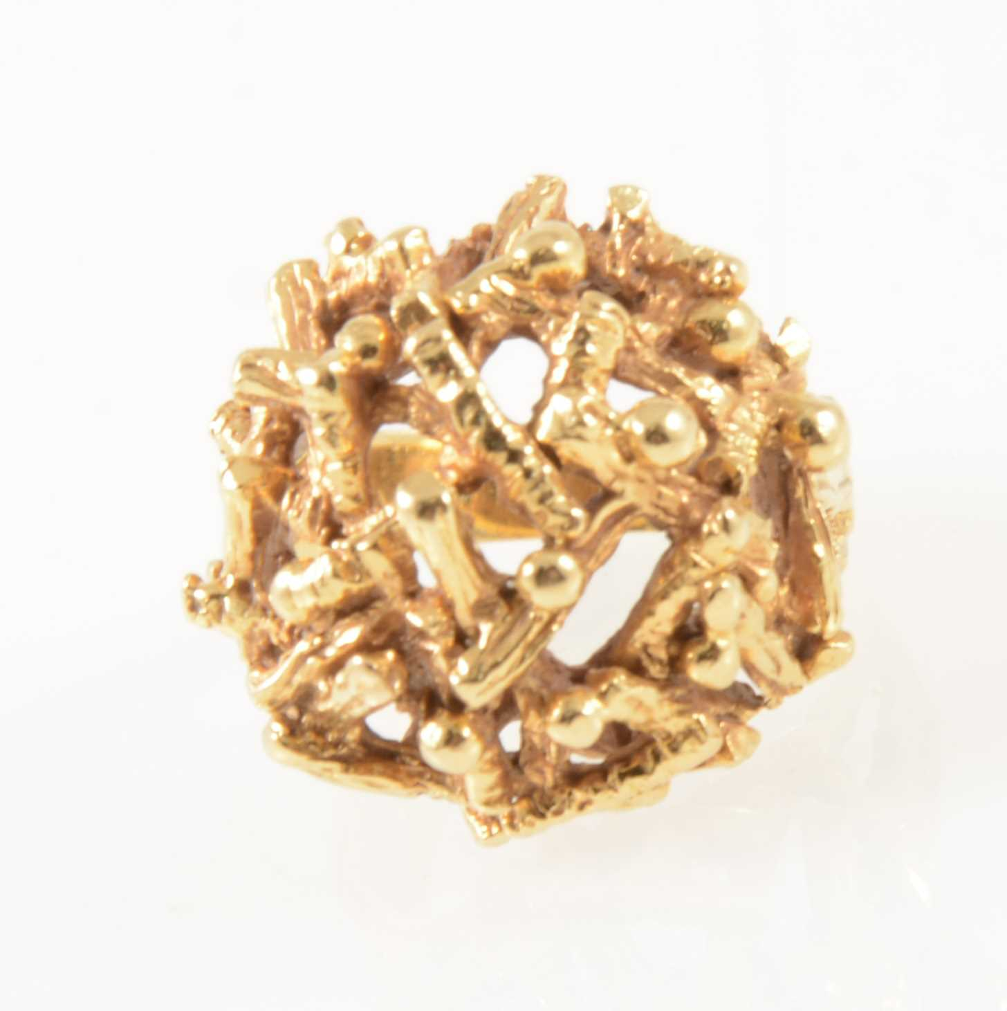 Lot 43-A yellow metal dress ring, domed textured twig design.
