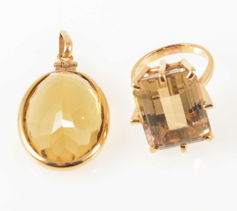 Lot 42-A smoky quartz dress ring and citrine pendant.