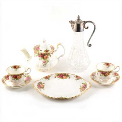 Lot 60-A Royal Albert tea service, Old Country Roses pattern, and claret jug with silver-plated mounts.