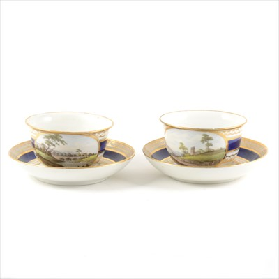 Lot 8-A pair of Derby style porcelain breakfast cups and saucers, with named views, Nr Caernarfon, South Wales