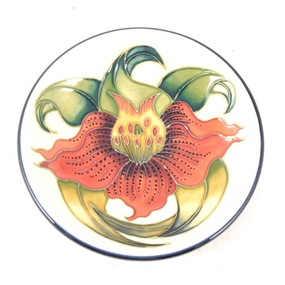Lot 27-Moorcroft pottery circular dish, Anna Lily, dated '98, diameter 12cm, boxed.